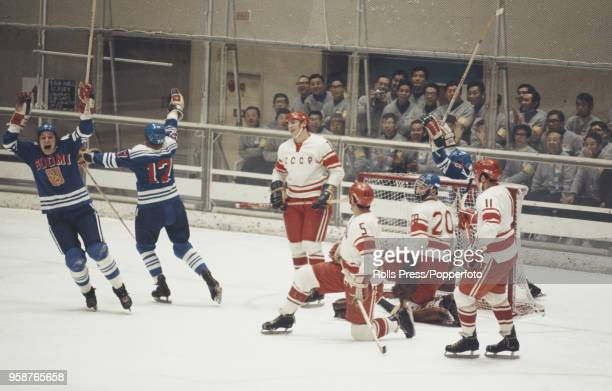 View of action between Finland and the Soviet Union in the Men's ice hockey tournament at the 1972 Winter Olympics at the Makomanai Ice Arena in...