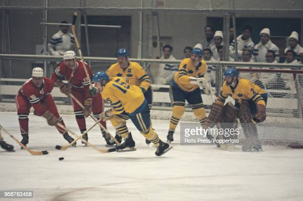 View of action between Sweden and Yugoslavia in the Men's ice hockey tournament at the 1972 Winter Olympics at the Makomanai Ice Arena in Sapporo...