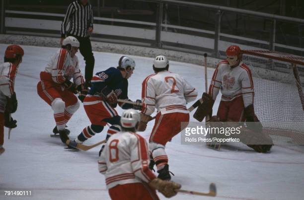 View of action between The United States and Poland in the Men's ice hockey tournament at the 1972 Winter Olympics in the Makomanai Ice Arena in...