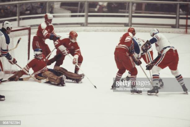 View of action between the United States and Switzerland in the Men's ice hockey tournament at the 1972 Winter Olympics at the Makomanai Ice Arena in...