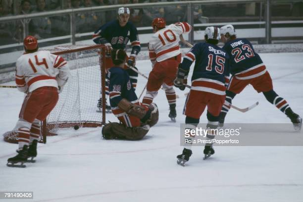 View of action between The United States and the Soviet Union in the Men's ice hockey tournament at the 1972 Winter Olympics at the Makomanai Ice...