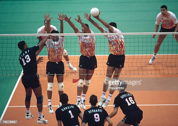 View of action during the final of the Men's volleyball event between Italy and the Netherlands at the 1996 Summer Olympics in the Omni Coliseum in...