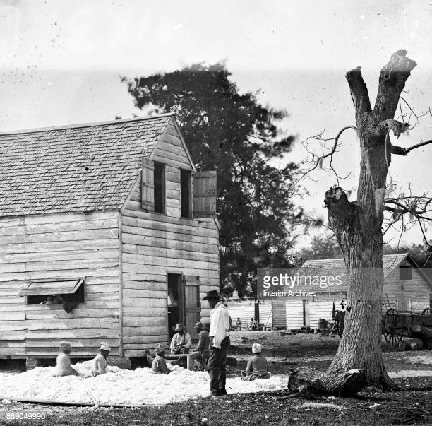 View of activity outside the cotton gin house on the Smith plantation Port Royal Island South Carolina 1862