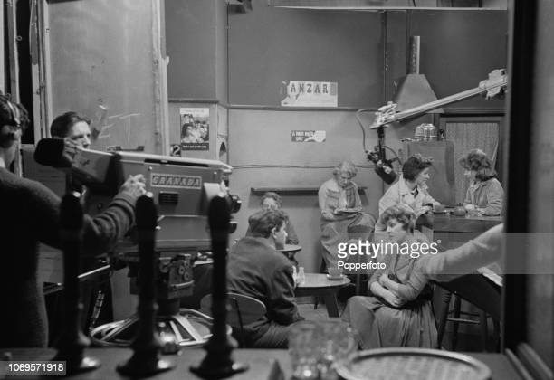 View of actors and production staff filming a cafe scene for an episode of the Granada Television soap opera 'Coronation Street' in Manchester...
