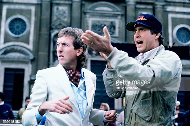View of actors Eric Idle and Chevy Chase on the set of the film 'National Lampoon's European Vacation' 1985