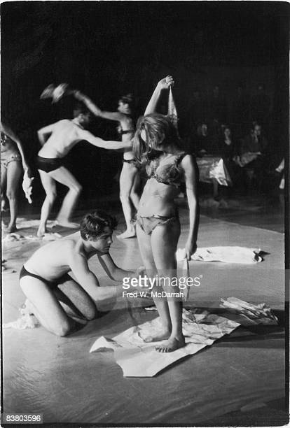 View of actors on stage as they perform Carolee Schneemann's performance art piece 'Meat Joy' in the Judson Memorial Church auditorium New York New...