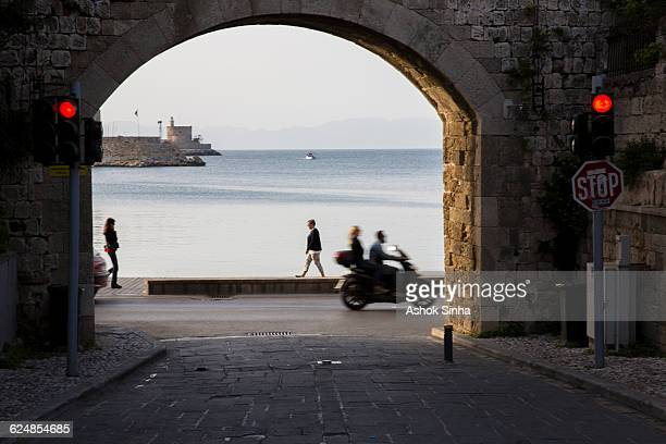 view of aegean sea through archway, athens - aegean sea stock pictures, royalty-free photos & images