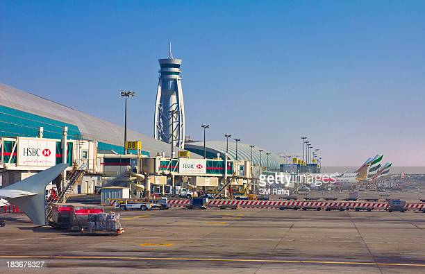 CONTENT] A view of aeroplanes parking berth at Dubai International Airport UAE