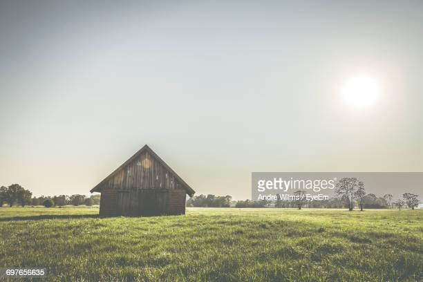 view of agricultural field against clear sky - andre wilms eyeem stock-fotos und bilder