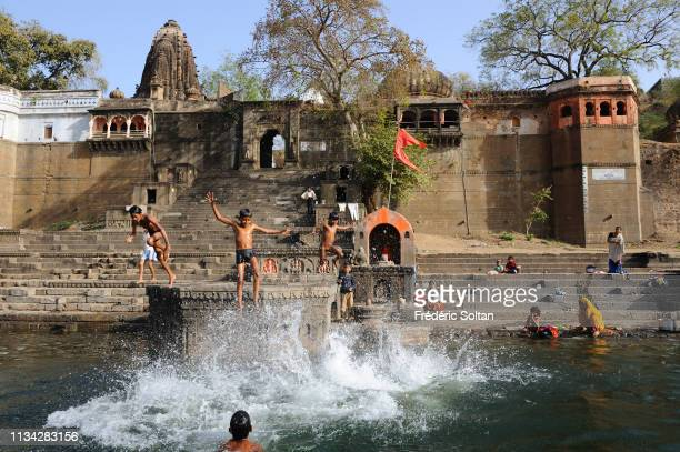 View of Ahilya Fort hindu temples and ghats on the Namada River in Maheshwar in Madhya Pradesh on March 10 2017 in India