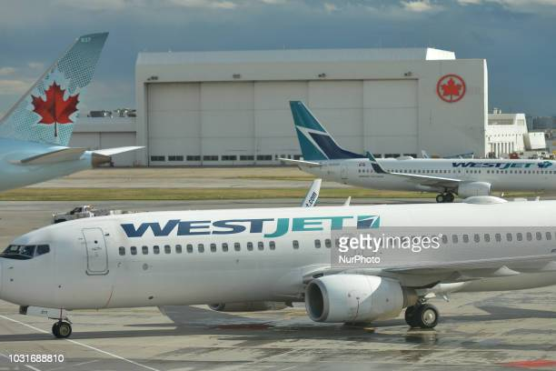 A view of Air Canada and WestJet planes at Calgary International Airport On Monday September 10th in Calgary Alberta Canada