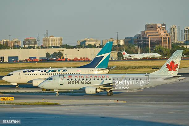 A view of Air Canada and WestJet planes at Toronto Pearson International Airport On Wednesday 20 July 2016 in Toronto Canada