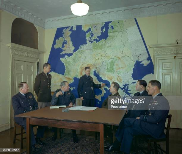 View of Air Chiefs meeting to plan the Allied Invasion of Europe pictured in front of a large map of the continent at a meeting room in London in...