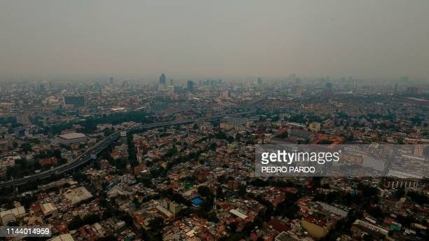 TOPSHOT View of air pollution in Mexico City on May 15 2019 Authorities in Mexico City and the metropolitan area study a contingency protocol for...
