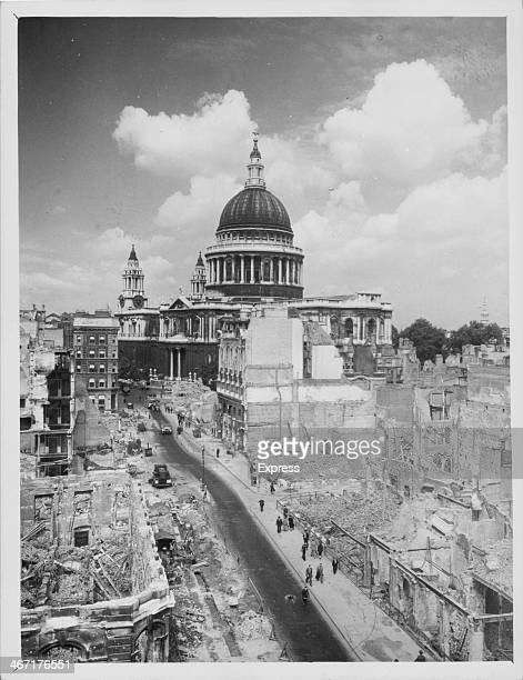 A view of air raid damage in London during the blitz with St Paul's Cathedral still standing in the distance World War Two England 1940