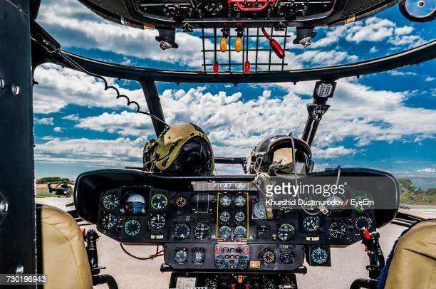 view of airplane against cloudy sky - helicopter photos stock pictures, royalty-free photos & images