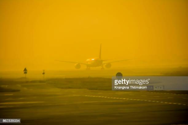 View of airplane taking off at New Delhi airport, India.