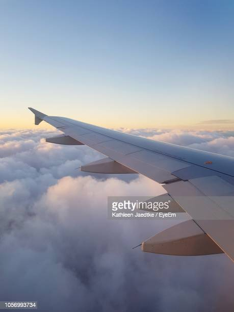 view of airplane wing against sky - aircraft wing stock pictures, royalty-free photos & images