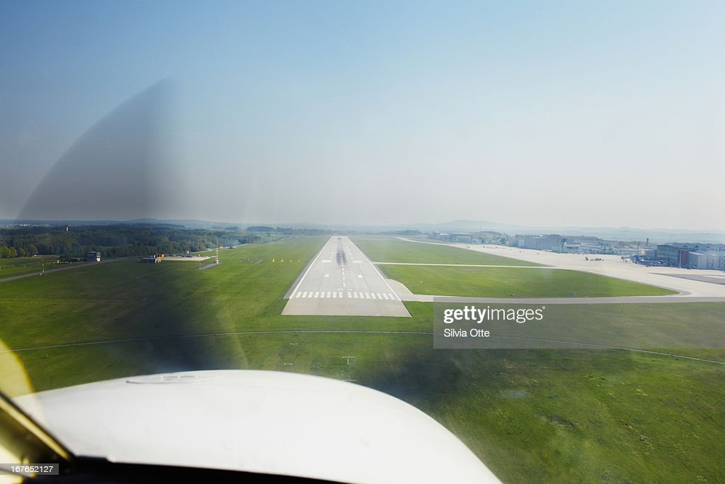 view of airport runway from plane : Stock Photo