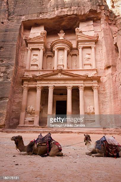 CONTENT] View of Al Khazneh with two camels resting on the foreground This temple is one of the most elaborated in the ancient Jordanian city of...