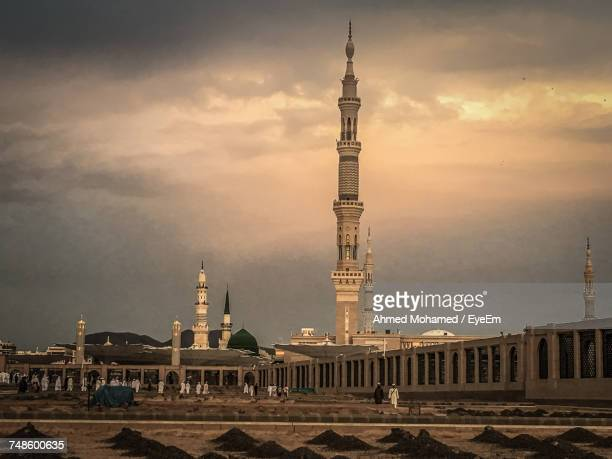 view of al madinah against cloudy sky - al madinah stock pictures, royalty-free photos & images