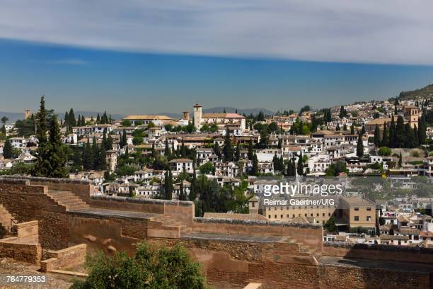 View of Albaicin Church of Saint Nicholas lookout and Iglesia del Salvador from Alhambra wall in Granada Spain