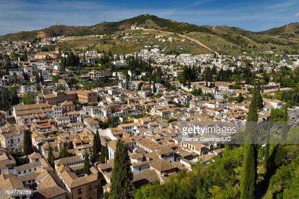 View of Albaicin with ancient wall from Alcazaba fortress Alhambra in Granada Spain