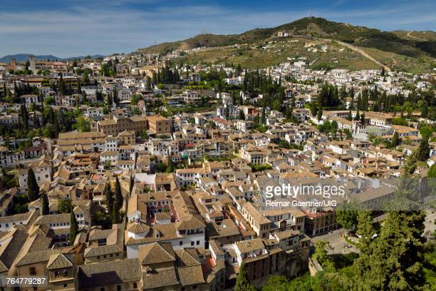 View of Albaicin with Church of Saint Nicholas lookout and Iglesia del Salvador from Alcazaba fortress in Granada Spain