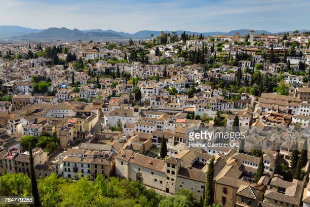 View of Albaicin with Churches and tile rooftops from Alcazaba fortress in Granada Spain