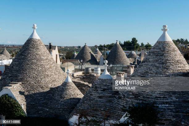 View of Alberobello a town in south east part of Italy in the Bari province with its unique costruction made with dry stone called Trulli The Trulli...
