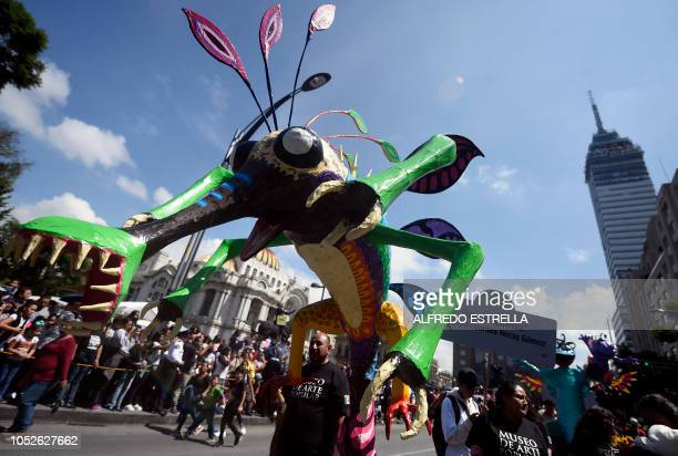 View of Alebrijes Mexican folk art traditional sculptures representing fantastical creatures during the tenth Monumental Alebrijes Parade and contest...