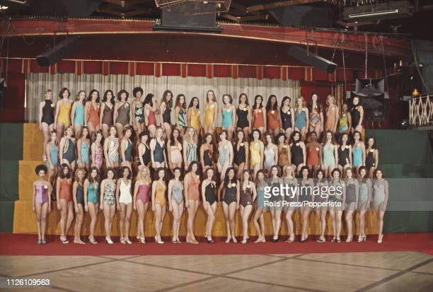 View of all the contestants who will line up to compete in the 1976 Miss World beauty pageant posed together in swimsuits for a photocall in London...