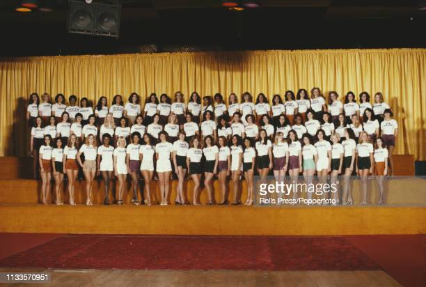 View of all the contestants who will line up to compete in the 1977 Miss World beauty pageant, posed together in t-shirts and shorts for a photocall...