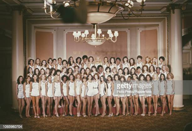 View of all the contestants who will line up to compete in the 1978 Miss World beauty pageant posed together in vests and shorts for a photocall at...