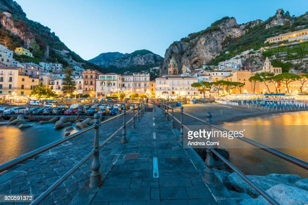 View of Amalfi village at dusk. Amalfi, Amalfi coast, Salerno, Campania, Italy