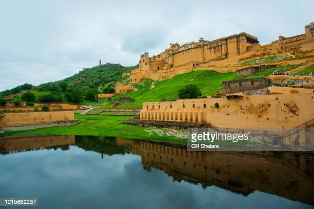 view of amber palace (amber fort) and maota lake, jaipur, rajasthan, india - monument stock pictures, royalty-free photos & images