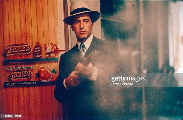 View of American actor Al Pacino fires a doublebarrel shotgun in a scene from the film 'The Godfather Part II' 1974