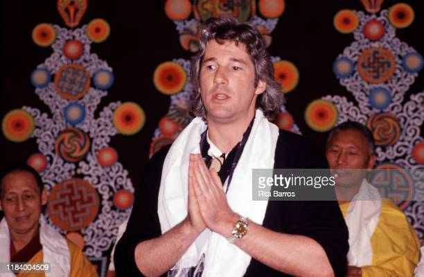 View of American actor and chairman of the Tibet House Richard Gere, with Indian monks from the Tantric Monastery of Gyuto, during a demonstration of...
