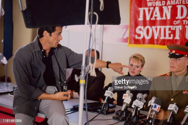 View of American actor and director Sylvester Stallone, Danish actress Brigitte Nielsen, and Swedish actor Dolph Lundgren during the filming of...