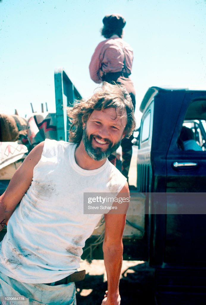 View of American actor and musician Kris Kristofferson as smiles on the set of his movie 'A Star is Born' (directed by Frank Pierson), 1975.