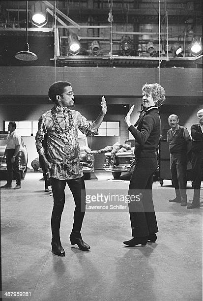 View of American actor and singer Sammy Davis Jr and actress and dancer Gwen Verdon during reheasals for the motion picture 'Sweet Charity' 1968...