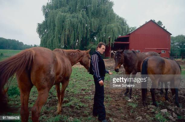 View of American actor Armand Assante with several of his horses at his farm Campbell Hall New York 1996