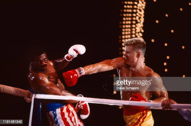 View of American actor Carl Weathers and Swedish actor Dolph Lundgren as they box in a scene from the film 'Rocky IV' , Los Angeles, California, 1984.