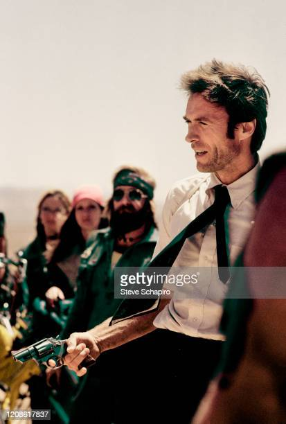 View of American actor Clint Eastwood a revolver in his hand on the set of his film 'The Gauntlet' 1976