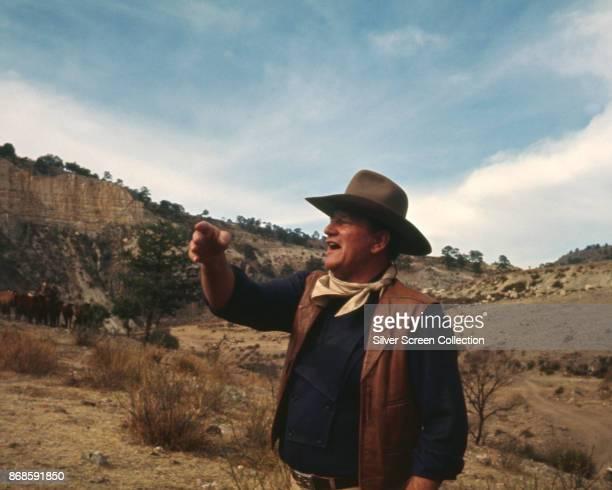 View of American actor John Wayne on the set of 'The Sons of Katie Elder' 1965