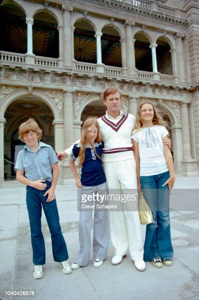 View of American actor Robert Redford as he poses with two of children Jamie and Shauna on the set of the film 'The Great Gatsby' Newport Rhode...