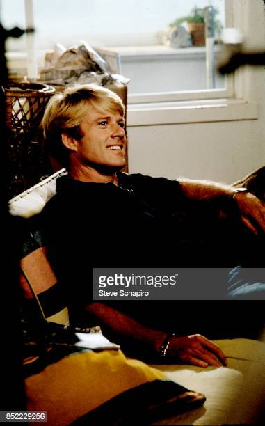 View of American actor Robert Redford as he sits on a sofa in his home New York New York 1968