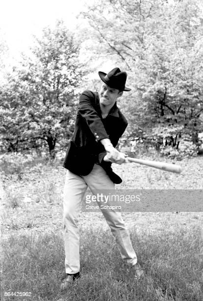 View of American actor Robert Redford in a black hat as he swings a baseball bat in Central Park New York New York 1966