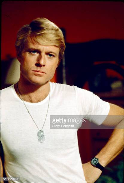 View of American actor Robert Redford in a white tshirt and militarystyle dogtags on the set of the film 'The Way We Were' 1973