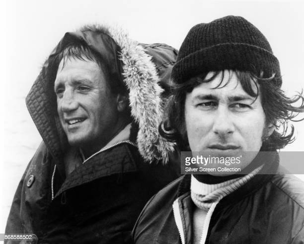 View of American actor Roy Scheider and director Steven Spielberg during the filming of 'Jaws' 1975